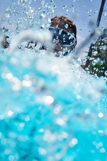 Girl splashing water in swimming pool by Sami Sarkis Photography