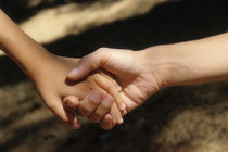 Mother holding son's hand by Sami Sarkis Photography