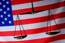 Scales of Justice and American flag by Sami Sarkis Photography