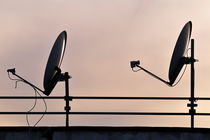 Two Satellite dishes and sunset sky by Sami Sarkis Photography