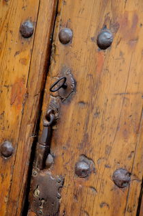 Wooden door and keyhole by Sami Sarkis Photography