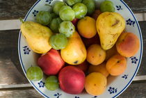 Variety of fresh summer fruit on a plate. by Sami Sarkis Photography