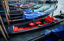 Empty gondolas floating on narrow canal by Sami Sarkis Photography