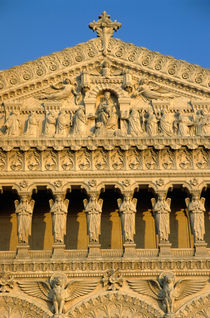 Ornate facade of the Basilica of Notre-Dame de Fourviere at sunset by Sami Sarkis Photography