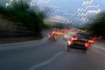 Cars moving on a highway as seen through a blurred windscreen by Sami Sarkis Photography