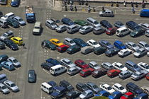Crowded carpark full of cars by Sami Sarkis Photography