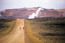 Two bikers on a dirt road leading to a geothermal power station at Myvatn von Sami Sarkis Photography