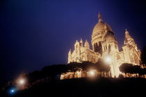 Sacre Coeur lit up at night with flood lights by Sami Sarkis Photography