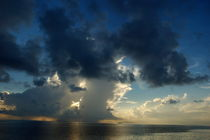 Sunrise over the clouds and sea by Sami Sarkis Photography