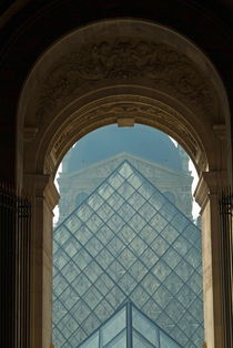 The pyramid of the Musée du Louvre seen through an arched window by Sami Sarkis Photography