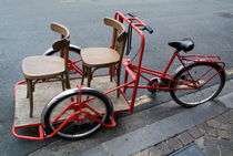 Two chairs on a red rickshaw by Sami Sarkis Photography