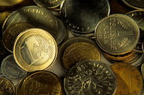 One euro coin among a pile of franc and deutsche mark coins. by Sami Sarkis Photography