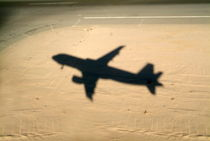 Shadow of airplane flying into land at Hurghada Airport von Sami Sarkis Photography