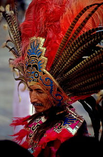 Man in traditional headdress to celebrate the Day of the Virgin of Guadalupe on December 12th in Mexico City by Sami Sarkis Photography