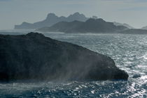 Waves crashing against Riou Island coast on a windy day by Sami Sarkis Photography