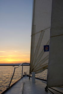 Sailboat navigating the sea at sunset by Sami Sarkis Photography