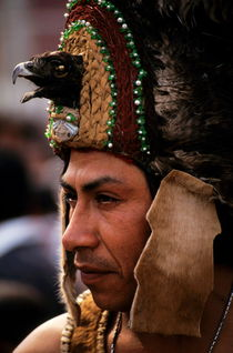 Indian man wearing a traditional headdress during the festival of the Day of the Virgin of Guadalupe in Mexico City by Sami Sarkis Photography