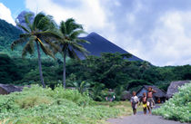 Melanesian boys walking by Yasur volcano by Sami Sarkis Photography