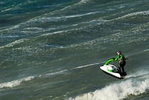 Man jumping on waves with jet-ski by Sami Sarkis Photography