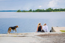 Two girls and a dog wating for the passenger boat  by kbhsphoto