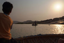 Young Boy Rowing Coracle On Tungabhadra River by serenityphotography