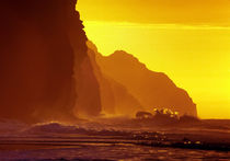 Cliff wave crash, orange sunset, Kauai, USA by Tom Dempsey