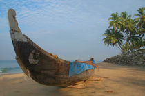 Boat-and-palms-on-black-beach-varkala