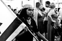 The girl with a flag of Israel on street parade, Israel by yulia-dubovikova