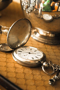 old watch in an antique shop by yulia-dubovikova
