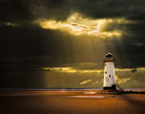 talacre lighthouse with sunbeams by meirion matthias