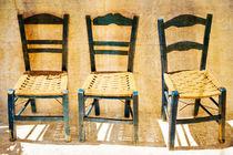 Three wooden chairs von pbphotos