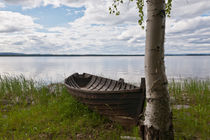 Old-fashioned row boat by a lake by kbhsphoto