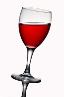 Stock-2-leaning-wine-glass-with-red-wine
